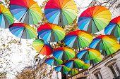 Colourful Umbrellas Decoration In The City Street Of Paris, Joyful Mood Of Multi Coloured Umbrellas. poster