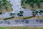 Cars Drive On Wet Road. Raining Streets, Rainy Day. Wet Asphalt, Aerial View. Malaysia. poster