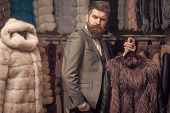 Businessman With Expensive Overcoat. Guy With Beard Buys Furry Coat. Fashion And Shopping Concept. M poster