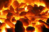 glowing coals with metal stuff background texture
