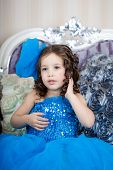 ?ute little girl, a child in a gorgeous dress in the room