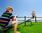 stock photo of seesaw  - Kids playing at the see - JPG