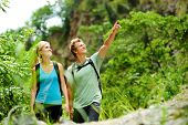 pic of stroll  - cute couple have fun together outdoors on a hike - JPG