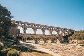 Pont Du Gard Is - Ancient Roman Aqueduct On The Gardon River - Vers-pont-du-gard In Southern France poster