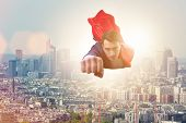 Superhero businessman flying over the city poster