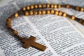 Bible with rosaries-beads crucifix