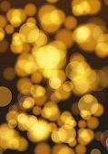 Golden Lights Background. Christmas Lights Concept. Abstract Golden Lights Bokeh And Sparkles. Bokeh poster