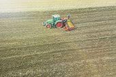 Farmer Seeding Crops At Field. Seeding Aerial View. poster