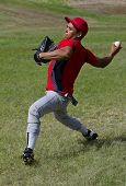 Baseball player throws the ball