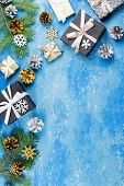 Blue Christmas Frame With Fir Branches, Black Giftboxes, Silver And Golden Decorations poster