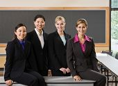 Multi-ethnic female co-workers posing in conference room