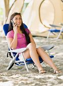 Woman talking on cell phone at campsite