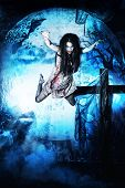 Bloodthirsty vampire flying at the night cemetery in the mist and moonlight. poster