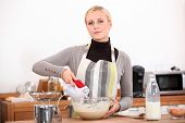 Woman with a blender in the kitchen