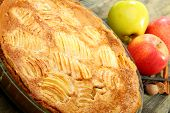 stock photo of alsatian  - Alsatian apple pie closeup on wooden table.