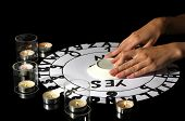 stock photo of ouija  - spiritualistic seance by candlelight close - JPG