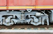 picture of boxcar  - Wheels and springs of freight train boxcar on railroad tracks - JPG