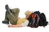 Traveller In Straw Hat Lies On Backpack And Sleeps poster