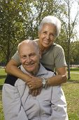 stock photo of senior-citizen  - Loving handsome senior couple relaxing in the park - JPG