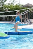 picture of tarzan  - Teenager playing in tarzan pool Water Park Rhodes - JPG