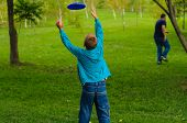 picture of frisbee  - Little boy playing frisbee on green grass - JPG