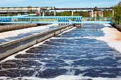 stock photo of aerator  - Water treatment tank with waste water with aeration process - JPG