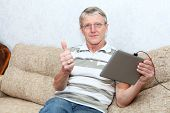 Senior Caucasian Man And Tablet Computer  Thumb Is Up  Domestic Room, Sofa poster