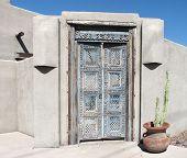 Old intricate design on doorway in Pueblo style home.