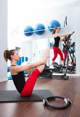 Aerobics pilates gym women group with crosstrainer