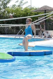 picture of tarzan  - Teenager playing in tarzan pool Water Park Rhodes - JPG