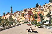 View of promenade and old medieval town with multicolored houses of Menton on french riviera in Fran