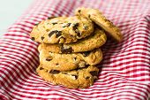 Chocolate chips cookies on red napkin