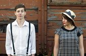 stock photo of old suitcase  - Retro hip hipster romantic love couple funny face vintage industrial setting - JPG