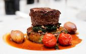Tenderloin steak with spinach, sweet onions and cherry tomatoes