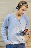 Young male going through song list