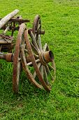 stock photo of chariot  - old broken wooden wheel spokes side by chariot - JPG
