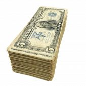 stack of vintage American money isolated on white background