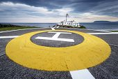 stock photo of coast guard  - Lighthouse at Fanad Head North Coast of Donegal Ireland with helicopter landing place - JPG