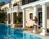 Pretty White Bikini Girl Walking Near Pool. Greek Style
