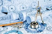 picture of construction machine  - Technical drawings with the bearing in a blue toning - JPG
