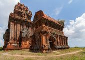 pic of champa  - Vietnam two impressive Banh It Cham towers on the green hill against the blue sky - JPG
