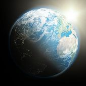 stock photo of northern hemisphere  - Space view of the sun rising over northern hemisphere on planet Earth - JPG