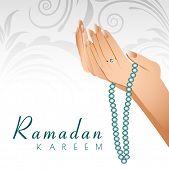 Ramadan Kareem background with female human hands holding rosary and praying(reading Namaz, Islamic