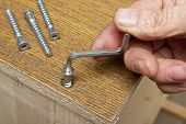 Tightening The Screws By Hand When Assembling Furniture