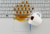 Coffee spilled on a laptop
