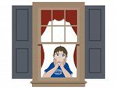 Sad boy in window sill with hands around chin