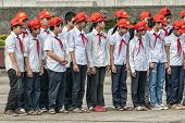 Group Of School Children In Uniform At Parade Ground Ho Chi Minh Memorial.