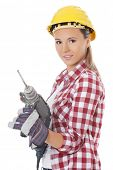 Woman in protective helmet and drill