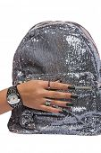 closeup of the woman�?�¢??s hand wearing luxury ring, black nail art manicure with sequin silver