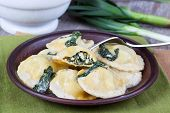 Homemade ravioli stuffed with ricotta and spinach on a fork